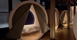The Dreamery includes nine private, cozy napping nooks outfitted with a Casper mattress, pillows, and sheets. Heavy curtains block out the light for a restful sleep.