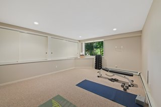 The laundry room, utility room, and gym are on the lower level with access to the rear lawn.