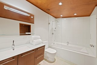 The master bathroom is fitted out with radiant heat, high-end Duravit fixtures, and a glass-capped vanity.