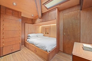 """The """"hotel"""" bedroom is crafted from mahogany with extensive built-in furnishings. The bathroom is down the hall."""