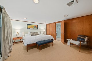 This spacious, ensuite bedroom is accessed from the vestibule.