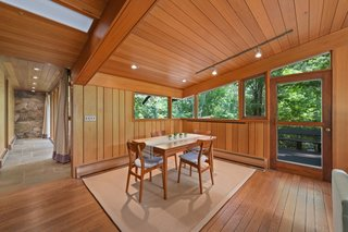 A door connects the dining area to the outdoor sun deck.