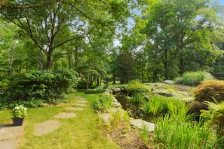 The property also includes a landscaped koi pond with ornamentals.