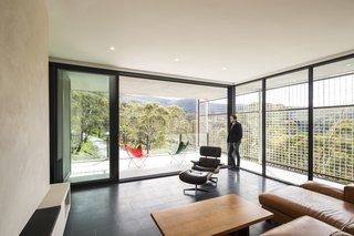 The light-filled living area features Bluestone paving and polished plaster walls.