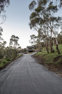 Nestled into the side of Mount Macedon, the home is on a remote site surrounded by nature, yet still within a commutable drive to Melbourne.