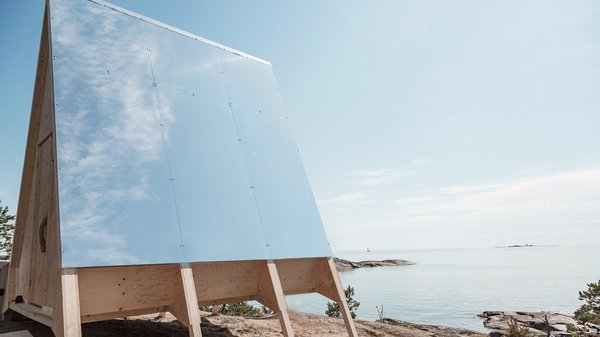Mirror panels cover one side of the roof to reflect heat and prevent the cabin from overheating.