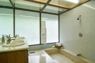 The beautiful bathroom floors were made from a mix of terrazzo and marble salvaged from the broken pieces of the John Hancock Building. This material was also used for the kitchen table and the flooring for the kitchen and foyer.