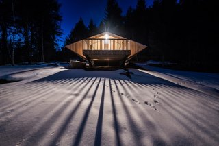 The renovated chalet is clad entirely in untreated larch (including the roof and deck).