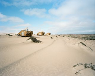 Shipwreck Lodge is located near the dry mouth of the Hoarusib River amidst a landscape of windswept sand dunes and salt-tolerant plants.