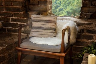 Soft textiles help turn the brick-and-stone structure into a more inviting space.