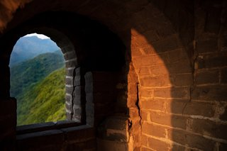 Arched windows frame views of the forested mountains of Yangqing.