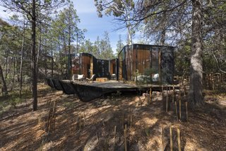Some pavilions overlook the water, while others are nestled further into the coastal bushland.