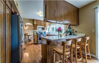 Before: The couple wanted to preserve the layout of the kitchen but replace the dark wood with brighter materials.