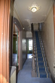 With worn walls, damaged ceilings, and dated carpet tiles, the former entrance was in desperate need of a refresh.