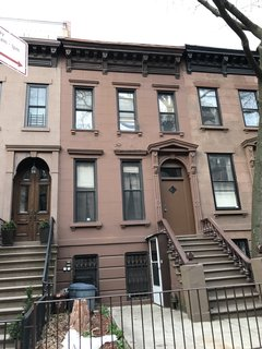 The Brownstone's former exterior blended in with its neighbors and required restoration and repairs.