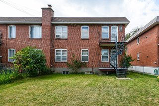 Seen from the back, the pre-renovation duplex—later dubbed the Bessborough Residence—also included a garage, backyard, and a basement that could be accessed from both floors.