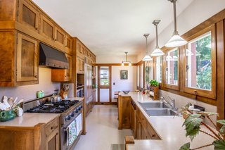 The spacious kitchen, which is located in the 1924 addition, features a Sub-Zero refrigerator and a Viking stove.