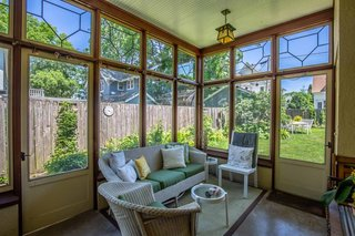 "This glazed porch was a 1924 ""non-Wright"" addition that overlooks the backyard."