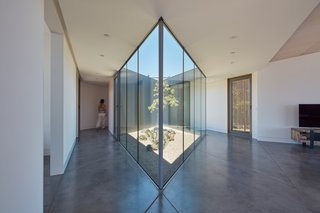 The house is organized around a diamond-shaped inner courtyard.