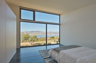 The master bedroom overlooks unobstructed views of Lake Berryessa.