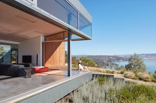 """The panoramic that wraps the house differs significantly on each side, such that the perception and experience of the place changes dramatically as one turns and moves around,"" add the architects."