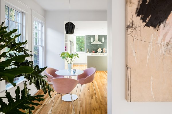 Medium Hardwood Floor and Pendant Lighting White oak tongue-and-groove flooring was used throughout the interior spaces.    Photo 9 of 15 in A Decaying 1920s Home Is Saved With a Mullet Renovation