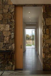 Floor Gres Architech porcelain floor tiles (in Ash Gray) line the entry and lower level corridor.