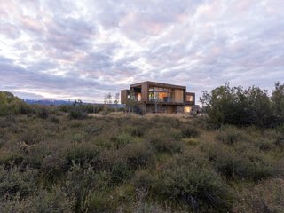 """""""Being a wetland, the site is covered in roughly 10' tall willow brush, and a small creek crosses the site lined with rugged Aspen trees,"""" explain the architects."""