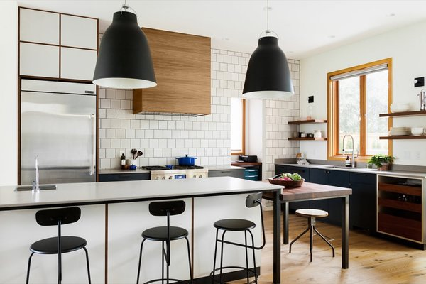The bulk of the kitchen island is covered in Caesarstone (4003 Sleek Concretd), while the kids' island is topped with a John Boos Edge Grain butcher-block in American Black Walnut.