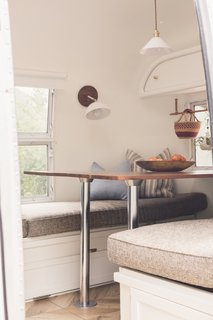 The table in the dining area folds down to make a bed; however, Bonnie says that the family actually prefers to sleep together in the convertible sofa area.