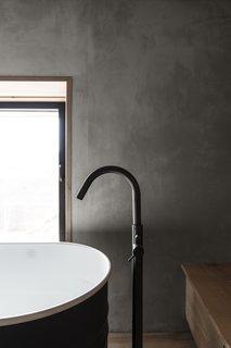 A close up detail of the bath faucet.
