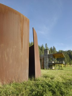 The modern home also includes one of Richard Serra's monumental sculptures made of weathering steel.
