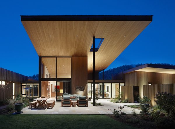 The extended overhanging roof with its tongue-and-groove hemlock soffit provides shade and shelter to the elevated courtyard.