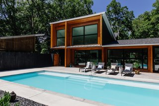 """My client's highest priority was building a pool,"" says Hannah. ""The property had 2 flat acres—rare in this neighborhood—which was ideal for a pool. We were able to do a very simple and modern granite pool with a beautiful contrast of concrete and decking... and still have room in the back yard for a giant vegetable garden."""