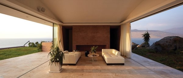Travertine lines the living room and dining area.