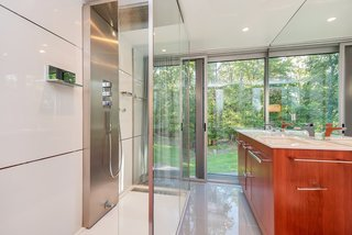 The Porcelanosa master bath with a walk-in rain shower.