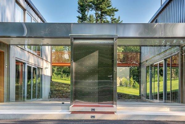 A massive steel pivot door marks the entrance.