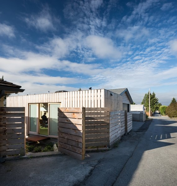 The office has been cladded in yellow cedar to comply with the city requirement that all shipping containers be clad.