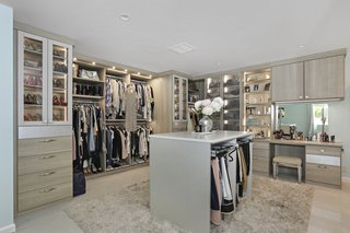 California Closets designed and built this custom wardrobe.