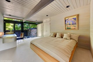 Including the cantilevered master suite, the bedroom wing houses three of the four bedrooms. Here is one of the secondary bedrooms, which overlooks a courtyard.