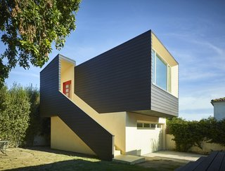 """""""Clad in economical fiber-cement siding, the ADU reaches down to the ground, while the stucco cladding of the garage reaches up, forming a semi-enclosed entry sequence,"""" says Martin."""