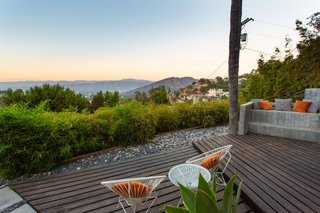A pair of Acapulco chairs provide comfortable seating for soaking in valley views.