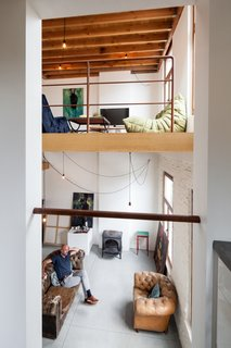 The view from the kitchen to the living area above and atelier below.