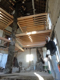The architects gutted the interior and inserted new floors in a spiral formation around the central support of the oak tree trunk.