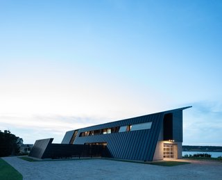 A Folded Steel Roof Shields a Fortress-Like Abode in Nova Scotia