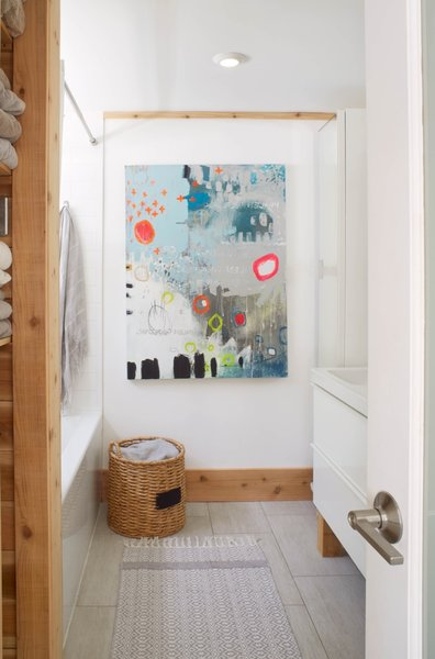 Christine created the 'Abstract No. 10, The Heavens Are Weeping' artwork hanging in the upstairs bathroom. Both bathrooms in the property feature heated ceramic floors.