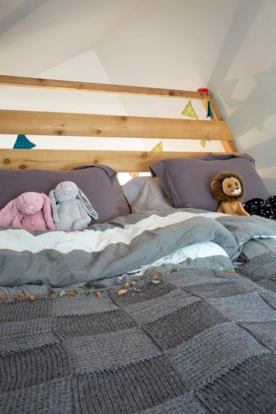 The cozy loft-space above the kids' playroom can be used as an additional sleeping area.