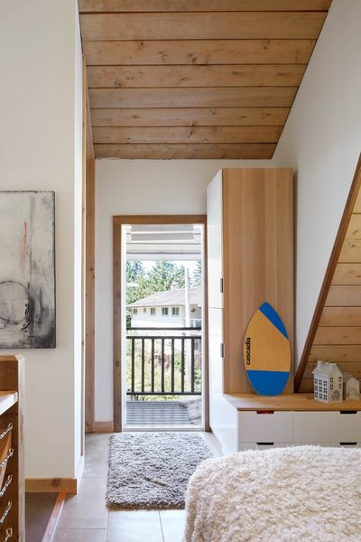 The master bedroom enjoys direct access to the outdoor balcony.
