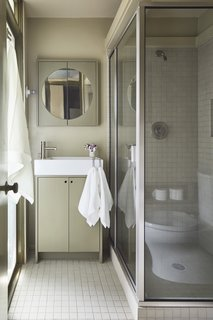 The bathroom was updated with new flooring and plumbing fixtures.
