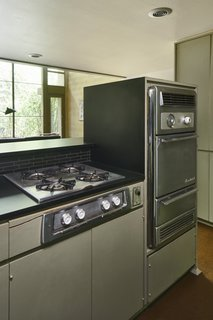 All three units still have their original cooktops and ovens. A dishwasher (not pictured) was a new addition.